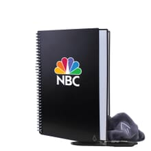 Black spiral-bound notebook with white and rainbow logo