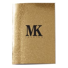 Glittery gold notebook with black logo