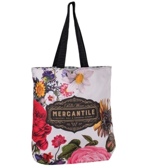 White tote bag with black straps, brown logo and multicolored all-over floral print
