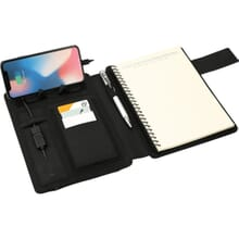 Dark gray notebook and wireless charging station