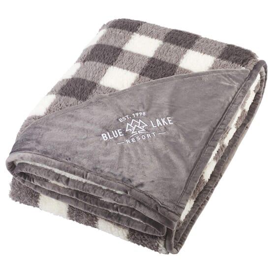 A blanket or throw with a custom logo